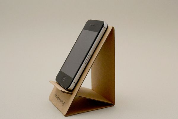 Cardboard dock with proper finishing (laminated with glossy paper etc). Can be reuse as phone dock