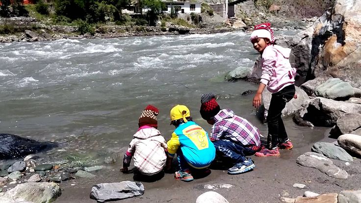 Children playing in the water of River Kunhar