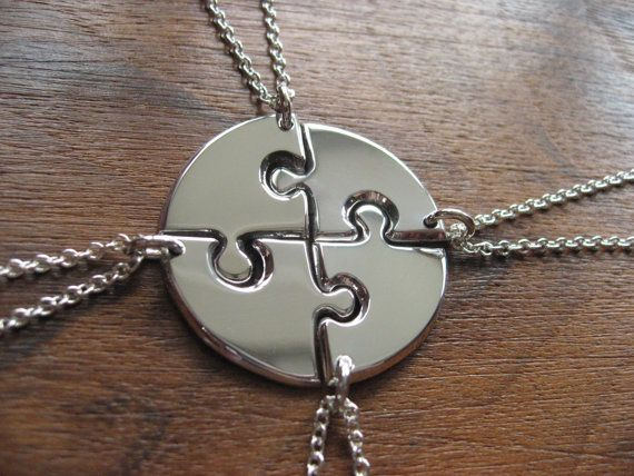 Four Puzzle Piece Circle Pendant Necklaces by GorjessJewellery, £160.00 - need it in 3 pieces.and not silver - copper would be great.  and not until we actually HAVE or third, lol.