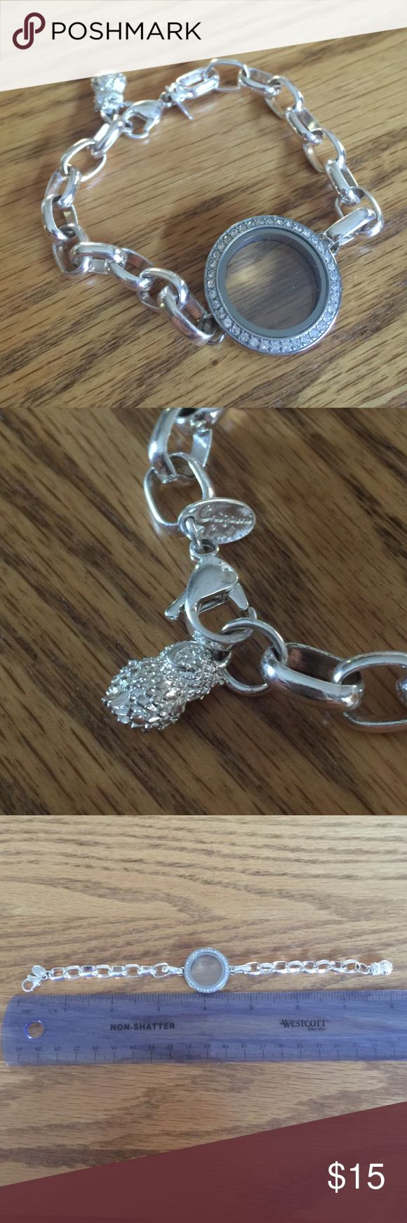 Origami owl bracelet Only worn once or twice! Like new. Comes from a smoke free, pet free home.  Origami owl Jewelry Bracelets