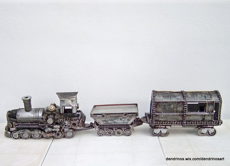 Metal sculpture of a train created by artist Giannis Dendrinos