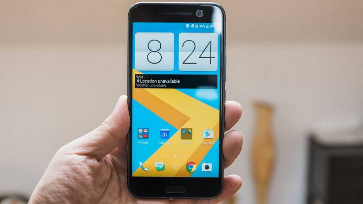 Black HTC 10 smartphone in a man's hand. Place your app screenshot inside easily on PicApp.net.