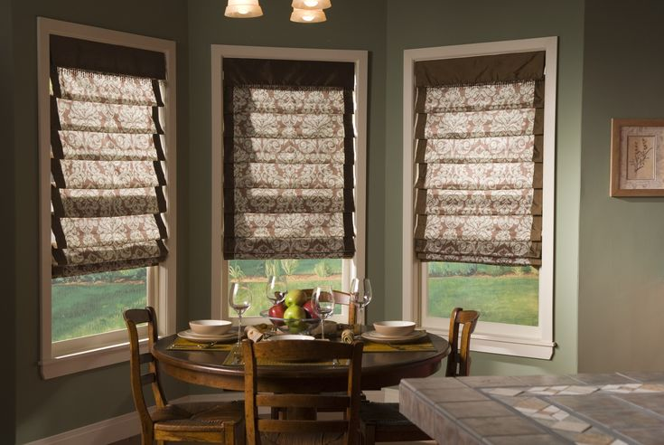 Soft romans make for a cozy breakfast nook | banded fabric | cordless roman shades | brown | neutral shades | bay window