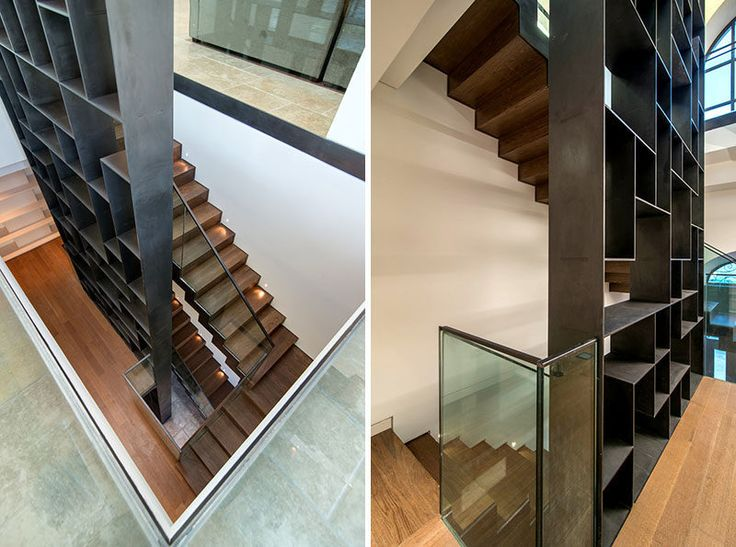 Stairs Design Ideas - 12 Examples Of Staircases With Bookshelves // This steel bookshelf travels upwards along side the stairs in this home.