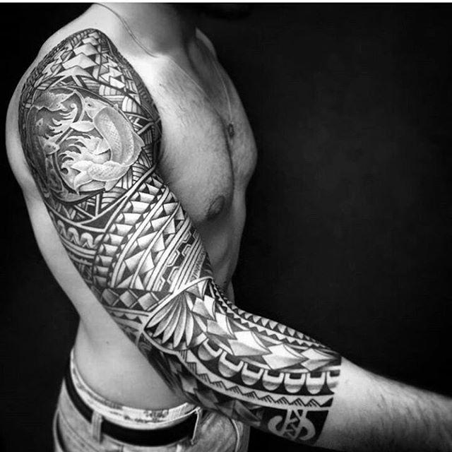 Tribal wave tattoo on wrist