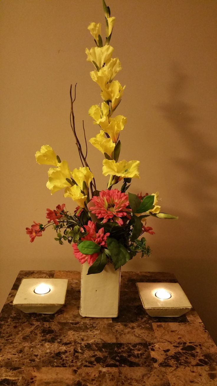Silk flower arrangement with candles centerpiece