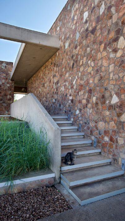 Thomas Gouws Architects - House Kleynhans Entrance bridge (Off-shutter Concrete & Stone wall)