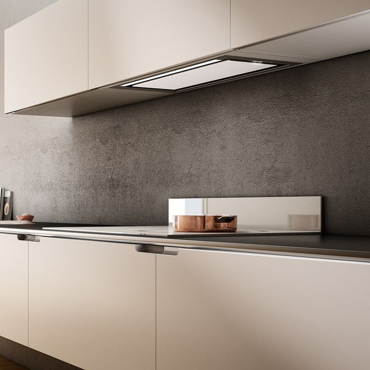 New from Elica - a built-in model kitchen hood. Elegant center steel or glass panel; LED diffuse lighting, touch controls and available in stainless steel and stainless steel/white glass finishes.