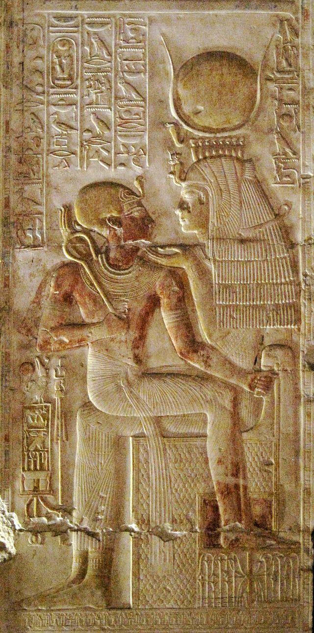 Pharaoh Seti I sitting on the lap of the goddess Isis, the patroness  of kingship