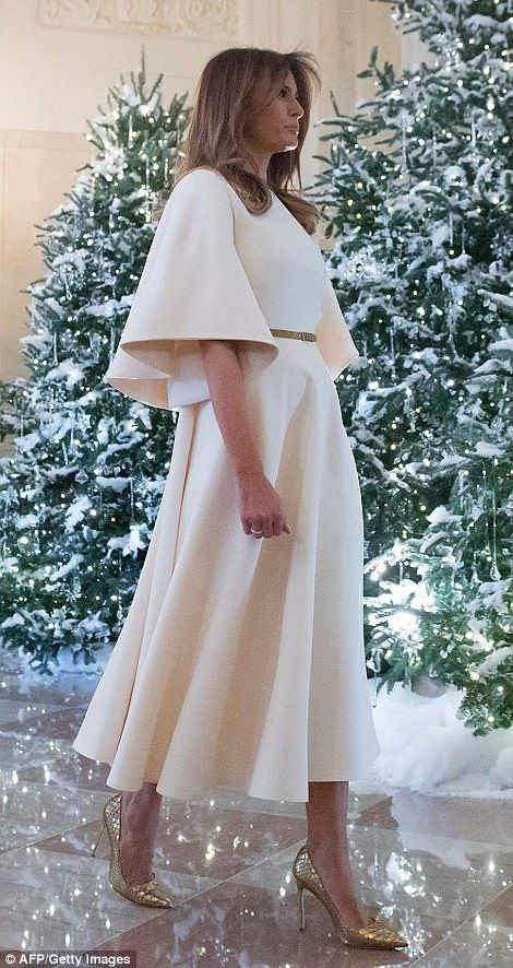 Melania's white dress with gold accent accessories fit in perfectly with the glittering decorations