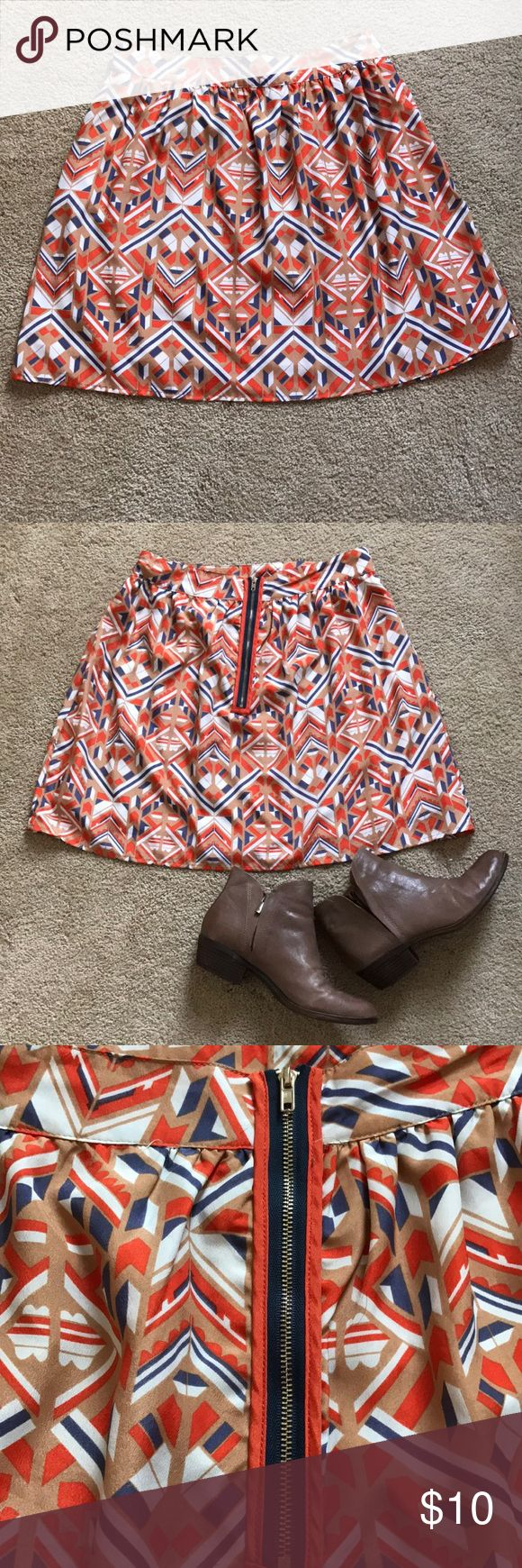 Aztec print skirt, size M Super cute Aztec print skirt in shades of tan, white, orange, & deep blue. Bought at Francesca's but never wore. New condition without tags. Zippered back. Hits a few inches above knees. Skirts Midi