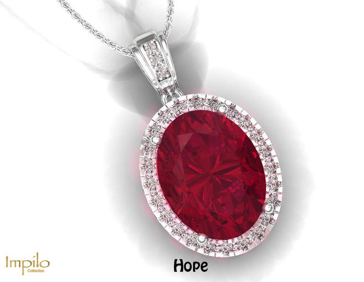 """""""Hope"""" - Beautiful and eye-catching, this pendant has a garnet centre stone with round brilliant cut diamonds in the halo and diamonds along the bail."""