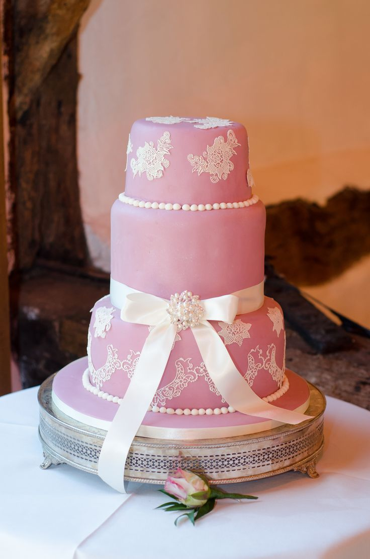 Pink and white lace three tier wedding cake