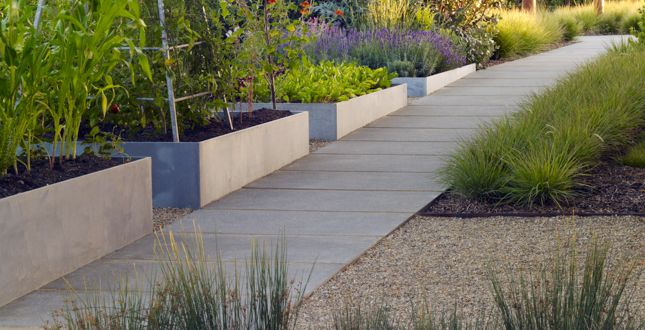 Sloped Walkway With Permeable Joints Along Raised Steel