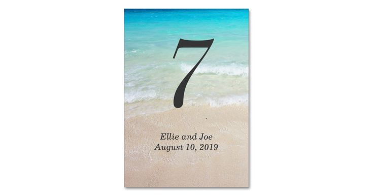 Pretty blue ocean water and sandy beach table number cards. Vertical cards with big black number which will show on both sides. Add the names of the bride and groom and wedding date also.