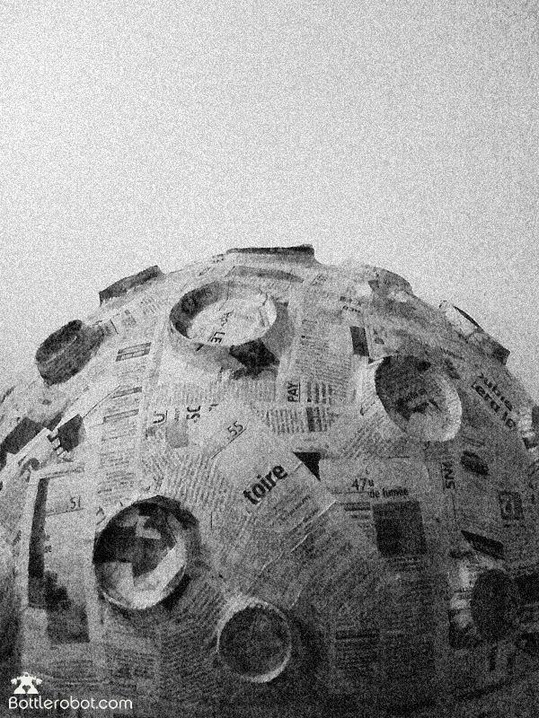 unpainted paper mache moon inspiration using upside down milk bottle tops.