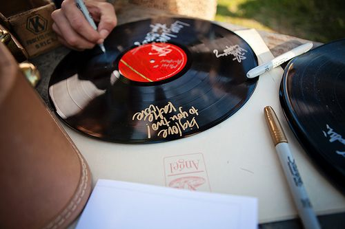 I love the idea of old records being part of the guest book! -- Bobbie & Mario's family-centric ranch wedding | Offbeat Bride