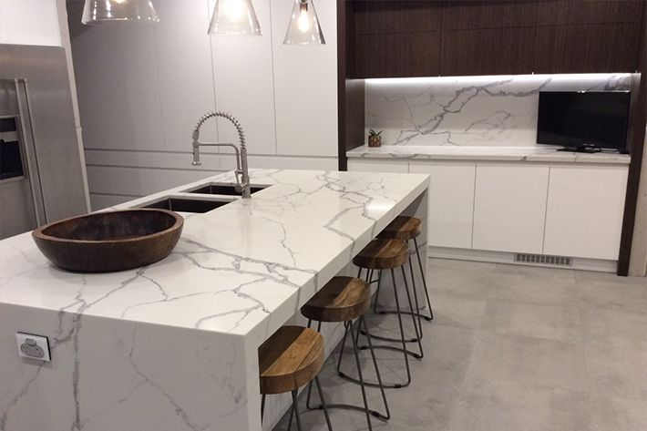Smartstone Statuario Venato benchtop and splashback in kitchen by Balmoral Homes