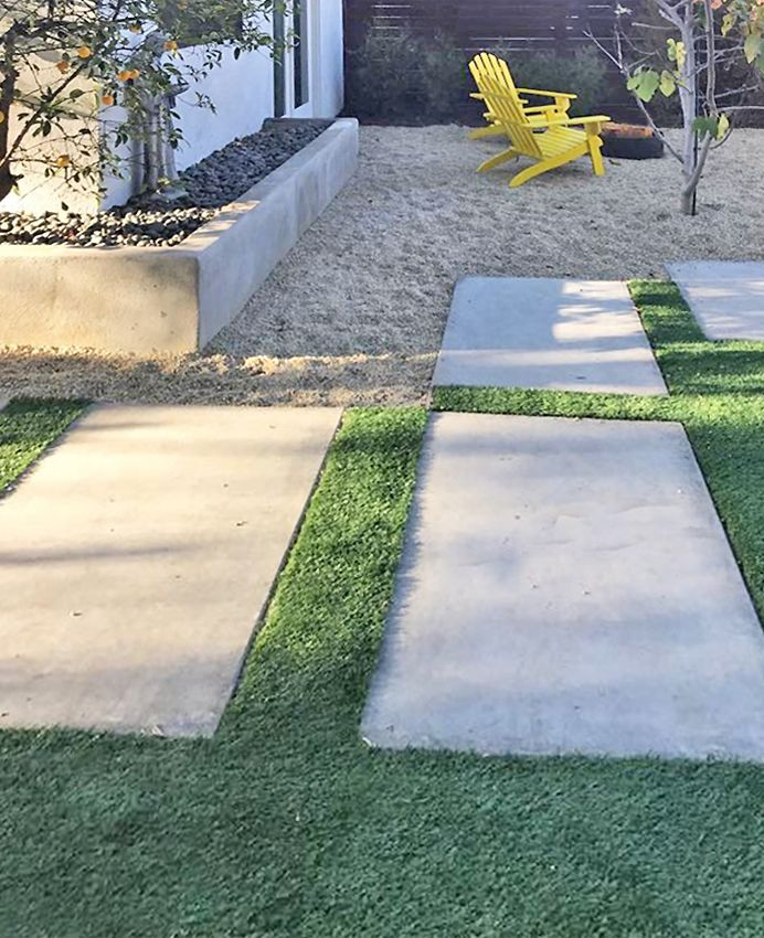 These large concrete pavers in artificial turf adjoin a sand