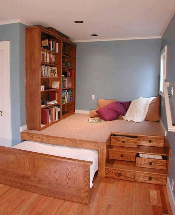 A good bedroom idea for a small space because it is compact and uses the space in a smart way like the bed being a pull out as well as the drawers on the steps. Drawers can also be added to the bookshelf or just replace the bookshelf entirely with a wardrobe.