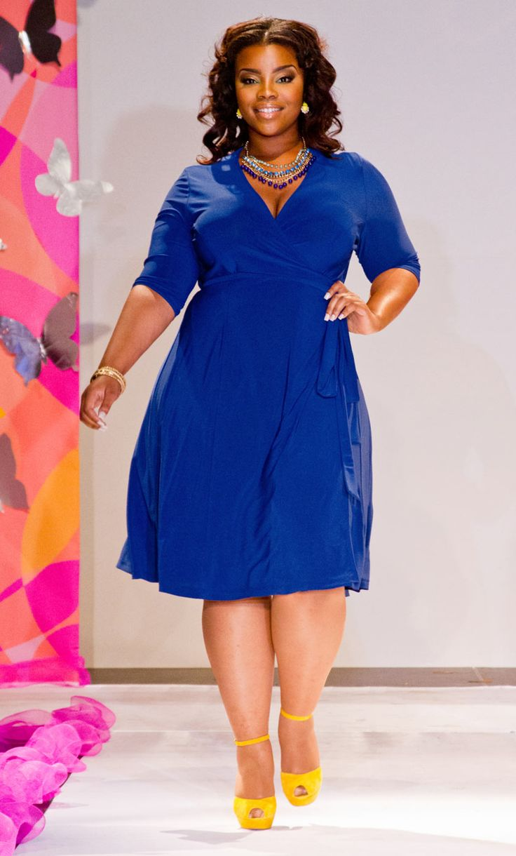Loving the blue and yellow combination with our plus size Essential Wrap Dress.  As seen at this year's Full Figured Fashion Week.  www.kiyonna.com  #KiyonnaPlusYou  #MadeintheUSA  #Kiyonna  #FFFW