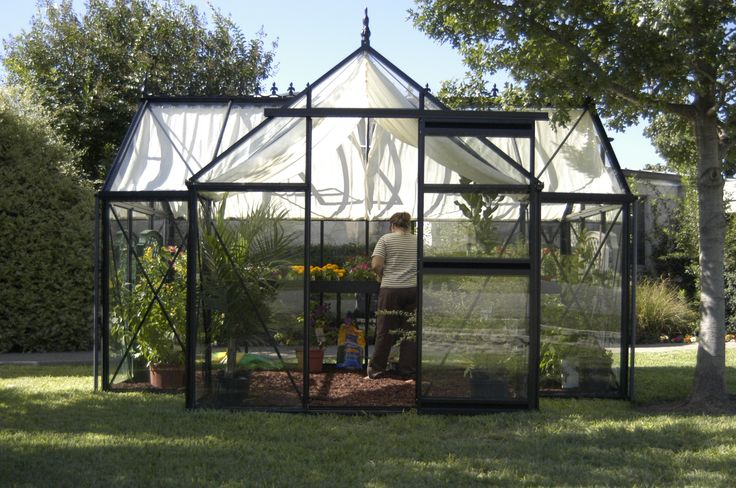 The Junior Victorian Orangerie Greenhouse includes a 3 in. high foundation frame, two roof windows, one window auto opener, and one sliding door.