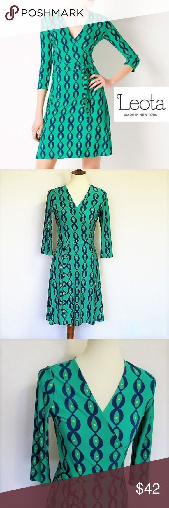 """Leota Faux Wrap Jersey Career Dress S NWT Leota Perfect Wrap Mini Dress size S NWT. Green with blue and yellow print. Faux wrap top A line skirt 3/4 sleeve Fabric tie 95% Polyester, 5% Spandex. Machine wash. No ironing needed Length from top to bottom: approx 36.5"""", Armpit to armpit approx 17.5"""" Waist: 14"""" laying flat Leota dresses are hand made in New York and are perfect for work or a night out D030 Leota Dresses"""