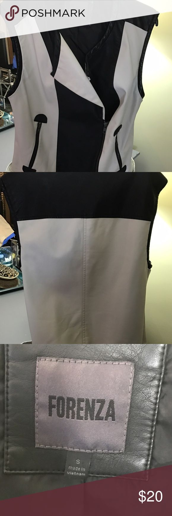 Soft beautiful black and white pleather vest. 😍 beautiful sleeveless vest.  In great condition.  Worn once.  Soft leather.  See picture 3 for material.  No rips.  Purchased at the Limited. forenza Jackets & Coats Vests