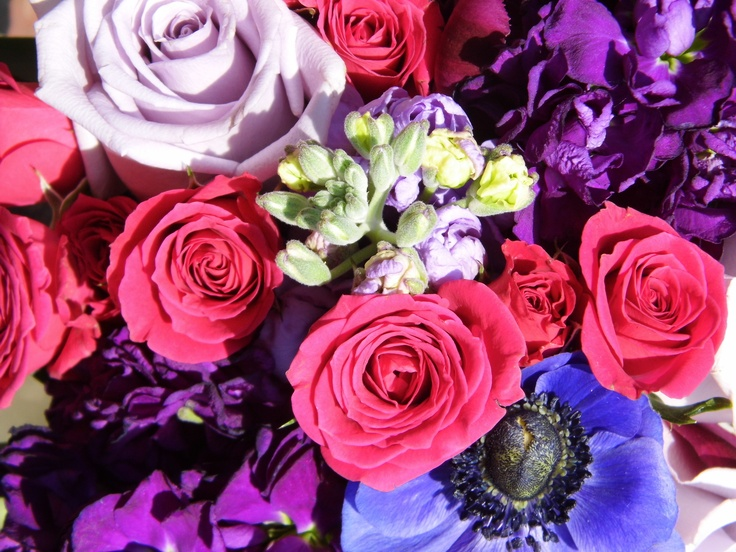 Bridal bouquet featuring pink and purple flowers created by Lexington Floral in Shoreview, MN.     #wedding #flowers #bride