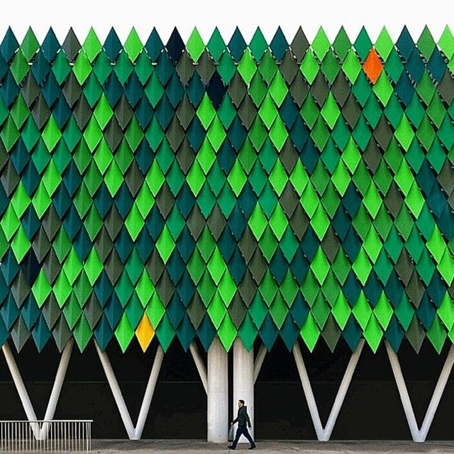 """ACXT-Idom's Bilbao Arena in Spain sports a facade of painted metal sheets…"