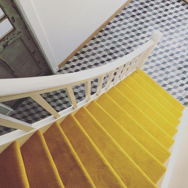 yellow staircase with vintage escher block tiles