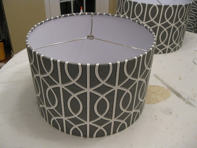 lamp shade covering tutorial.  Like the idea of using fabric glue on edge.  from Emily A. Clark blog