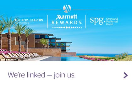 Pool and ocean view, Marriott Rewards, SPG and Ritz-Carlton Rewards logos