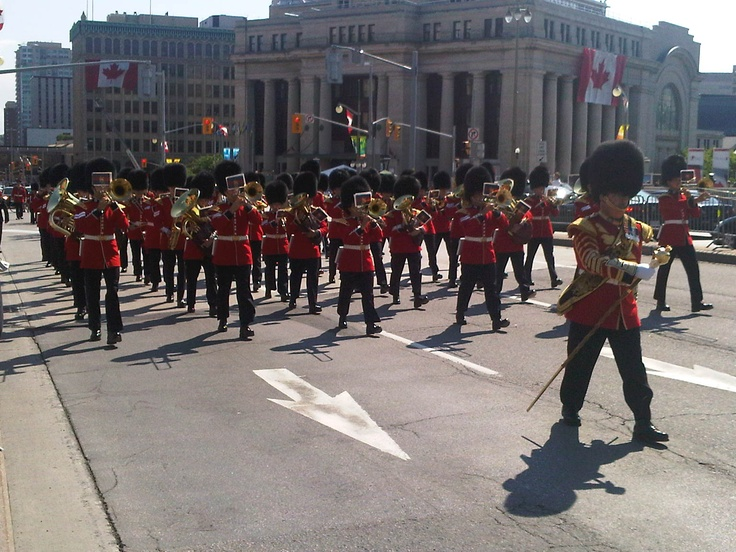 Daily Changing the Guard parade through downtown Ottawa in summer. For more information on capital sites and Canadian heritage visit http://www.ottawatourism.ca/en/visitors/what-to-do/capital-heritage