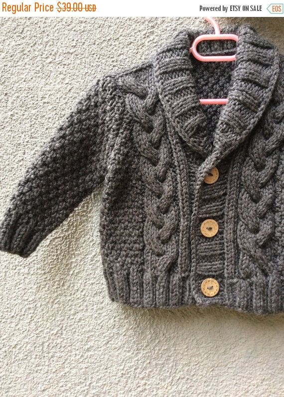 Knit Baby Grey Organic Cotton Sweater, Hand Knitted Gray Baby Cardigan, Baby boy Clothes, New Born Baby Gift for Baby Showers, Cable Knit coat  This small , tiny baby cardigan or sweater is hand made and knitted with %40 Wool % 60 Ayrclich acrylic yarn. It is perfect your little prince or princess.  All items are knitted in smoke free and pet free areas. All yarns are anti-allergic and All products are knitted with the yarns which are Turkey s best quality yarn company.  This sweater will…