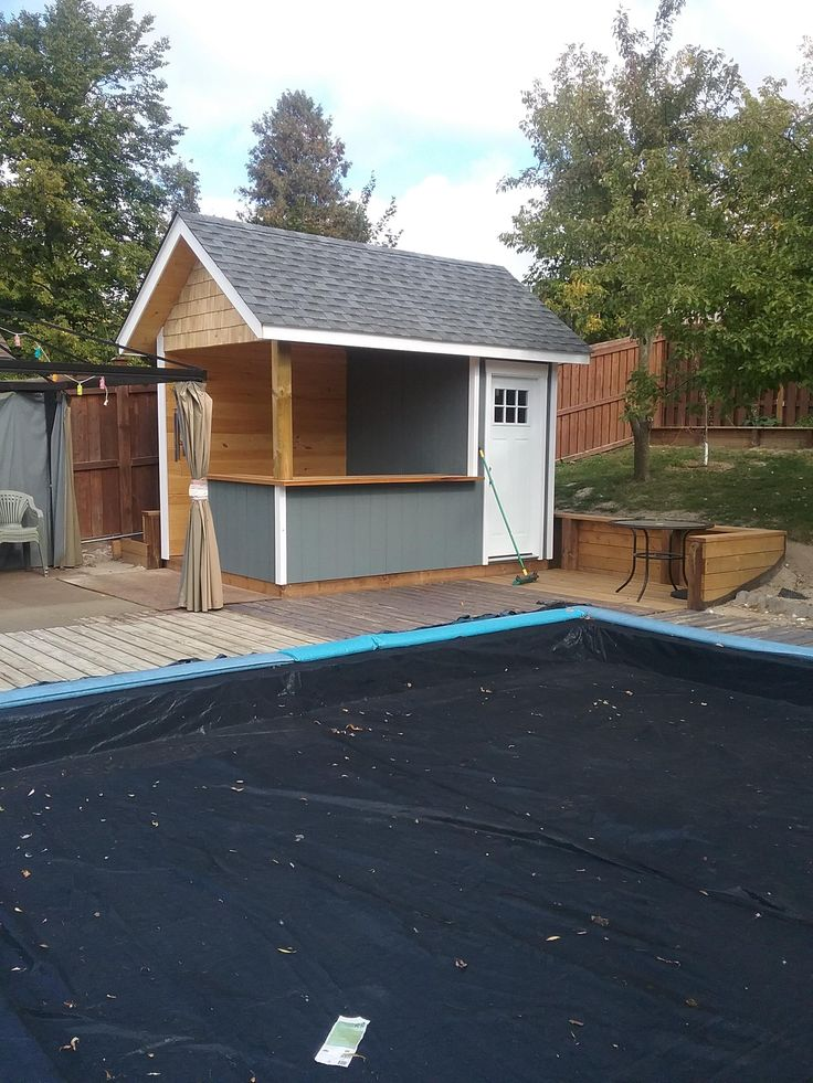 Backyard shed with built in bar for poolside entertaining