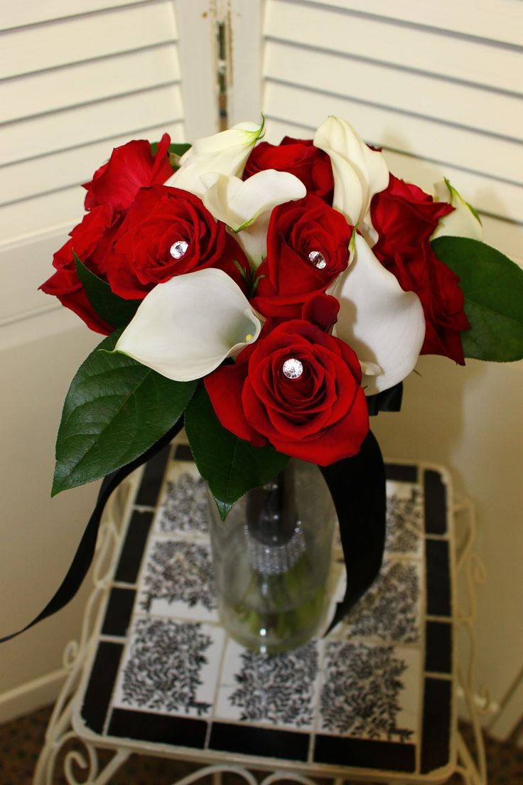 This sleek red rose and white calla lily bouquet is stunning with a black gem wrap!