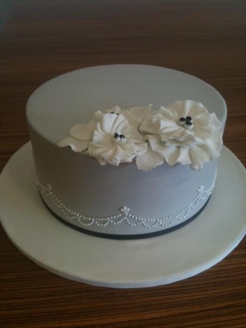 One Tier Cake With Flowers A One Tier White Ruffle Wedding Cake ...