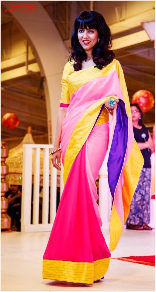 Pink georget and sequenced saree with a contrasting yellow gotta patti blouse.