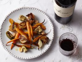 Roasted Carrots with Almonds and Olives : This Spanish-inspired roasted carrot dish gets salt and crunch from fat Cerignola olives and Marcona almonds. It pairs equally well with fish, turkey, or lamb and complements Chardonnay, Pinot Grigio, Merlot and Cabernet alike, making this dish your all-season starter or side.