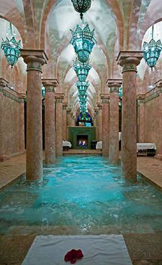 Hotel Riad Spa in Marrakech with aqua lighting and pool, Morocco | Cynthia Reccord See more at http://www.fashionisly.com