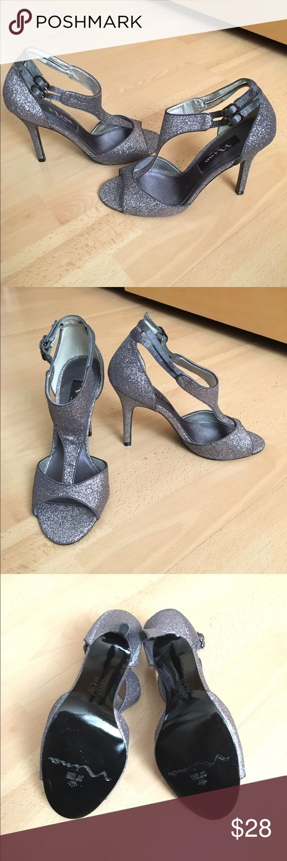 "Nina Glittery Lavender T-Strap Heels Brand new in box. These are a beautiful pair of heels! They are covered in silver, lilac, and lavender glitter. Great for a special occasion! The 3.5"" heel makes it fancy but still moderately comfortable. Because of the adjustable strap, could fit a size 5.5, 6, and even 6.5. I'm open to offers! Nina Shoes Heels"