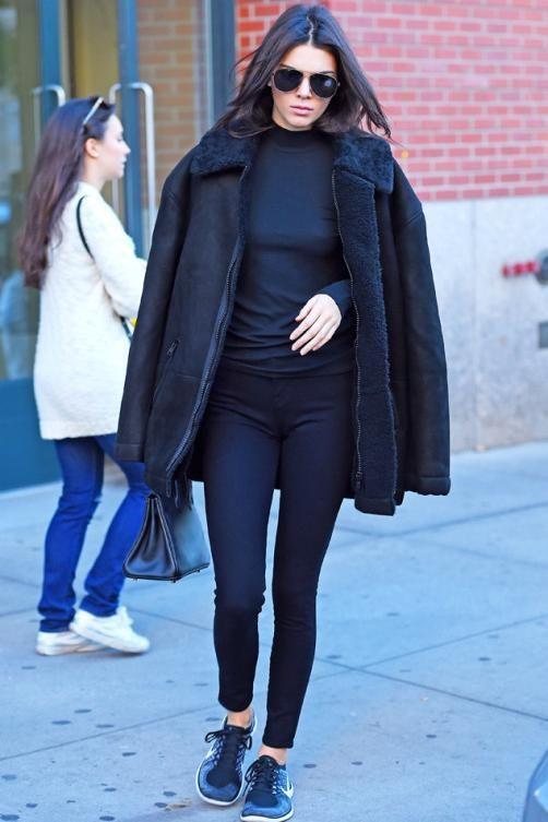 Kendall Jenner wearing Nike Free 4.0 Flyknit Sneakers in Black/Wolf Grey/Dark Grey