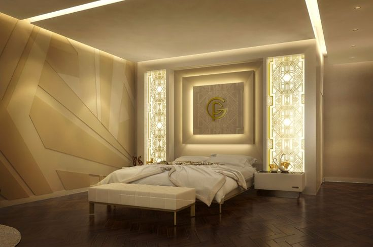 A luxurious master bedroom design in cream, white and gold with a pair of simple nightstands and the golden initials illuminated on the back of the bed.