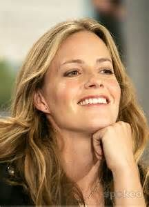 Actress Elisabeth Shue. She's extremely down-to-earth, open-minded and intelligent (she's a Harvard and Wellesley grad). She's also an accomplished soccer player. And she has an equally famous sibling: 'Melrose Place' actor Andrew Shue.