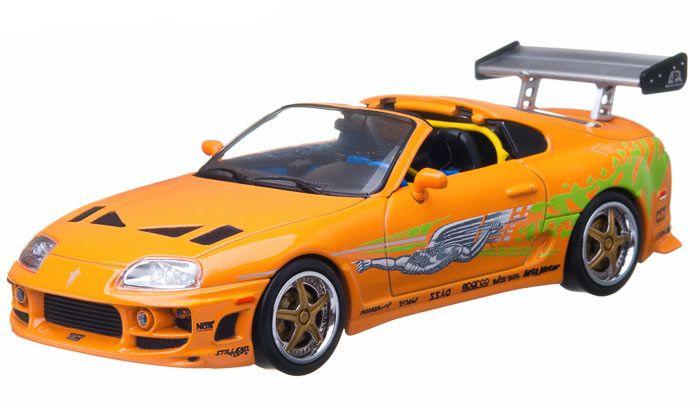 Coche Toyota Supra año 1995. Modelo naranja. A Todo Gas 7. Escala 1:18. Jada Toys Estupendo coche a escala del Toyota Supra del año 1995 en un modelo color naranja del exitoso film de A todo Gas 7, fabricado en metal y goma, a escala 1:18 y 100% oficial y licenciado. Perfecto como regalo de colección a todos los fans del film.