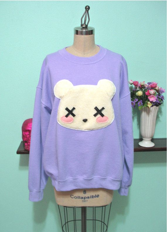 *BEST SELLER!* My customers cant get enough of the super soft interior and ultra-comfy fit of these sweatshirts! Each one is a soft and durable cotton/poly blend, which feels amazing on your skin and is easy to care for!  Part of a series of sweatshirts Im doing with fluffy shearling appliques, here is the Pastel Deaddy Bear sweatshirt! It has an applique of a dead teddy bear with a real stuffed animal plastic nose, rosy cheeks, and Xd out eyes.  (IMPORTANT NOTE: Lavender sweatshirts have a…