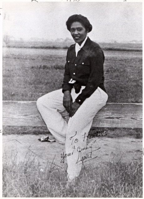 Janet Harmon Waterford Bragg, 1932.  Janet Bragg was a pioneer female African American pilot whose leadership in black pilot organizations in the 1930s created opportunities for others. She is seen here  sitting on a fence at Harlem Airport, Chicago. SI-79-13664