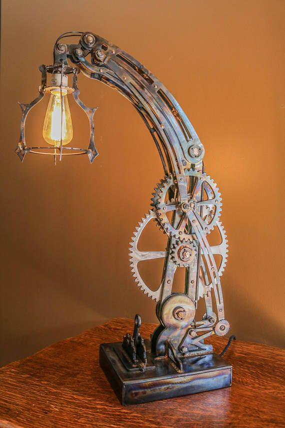 Handcrafted from authentic, heavy duty steel. Includes working gears that change the angle and height of the bulb and an oversized handle which functions as the switch (see pics). Each piece is cut directly from plate steel, heat treated and welded in the assembly process. An