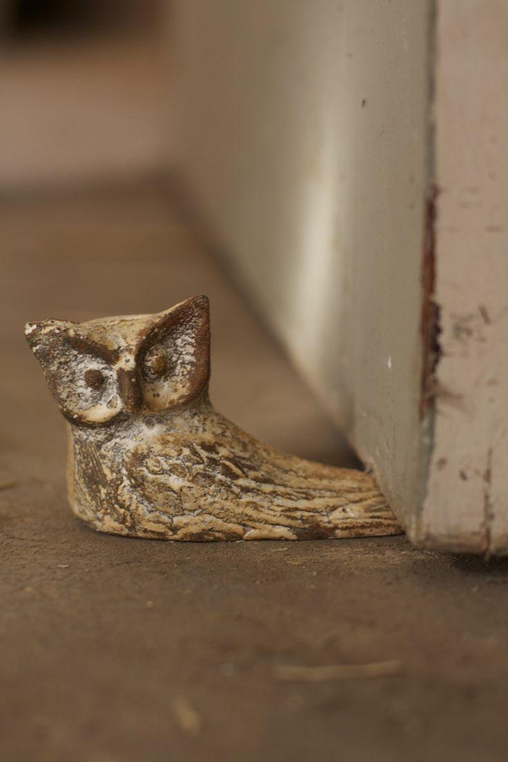 antique white cast iron owl doorstop